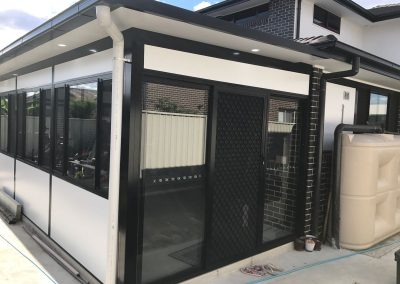 sunroom with grill door